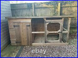Outdoor wooden dog kennel with covered run/enclosure